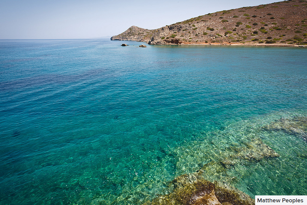 crystal clear blue waters of spinalonga