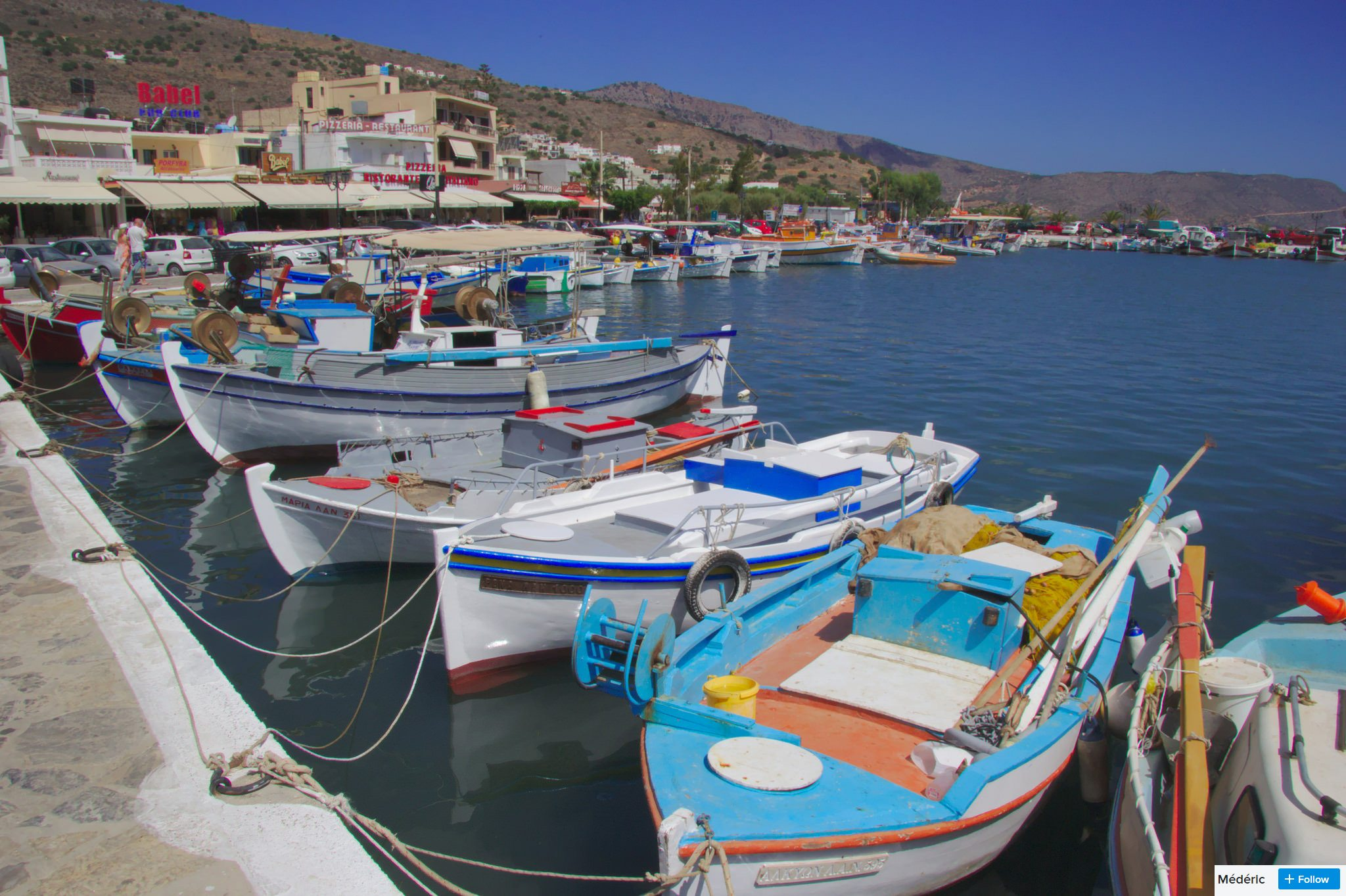 elounda harbour by day